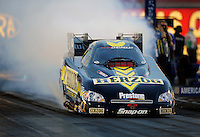 Oct. 31, 2008; Las Vegas, NV, USA: NHRA funny car driver Tony Pedregon does a burnout during qualifying for the Las Vegas Nationals at The Strip in Las Vegas. Mandatory Credit: Mark J. Rebilas-