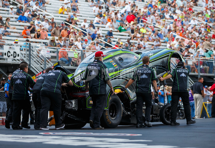 Jun 16, 2017; Bristol, TN, USA; Crew members for NHRA funny car driver Alexis DeJoria during qualifying for the Thunder Valley Nationals at Bristol Dragway. Mandatory Credit: Mark J. Rebilas-USA TODAY Sports