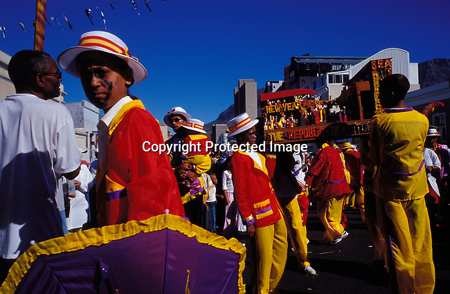 """dippcoo00059.People. Coons.  Cape Minstrels CAPE TOWN, SOUTH AFRICA - JANUARY 2: An unidentified participant during the yearly """"Coon Carnival"""" on January 2, 2003 in Cape Town, South Africa. The carnival performers are primarily mixed-race, or colored people and the carnival began in the early 19th century when slave bands played friendly competition during the annual Jan. 2 slave holiday. The parade has become a popular tourist attraction and the colorful floats are competing at a local stadium for days for the best costumes and performances..©Per-Anders Pettersson/iAfrika Photos.."""
