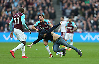 West Ham United's Mark Noble wrestles with a pitch invader<br /> <br /> Photographer Rob Newell/CameraSport<br /> <br /> The Premier League - West Ham United v Burnley - Saturday 10th March 2018 - London Stadium - London<br /> <br /> World Copyright © 2018 CameraSport. All rights reserved. 43 Linden Ave. Countesthorpe. Leicester. England. LE8 5PG - Tel: +44 (0) 116 277 4147 - admin@camerasport.com - www.camerasport.com