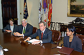 United States President George W. Bush meets with bi-partisan US House leaders to brief them on his speech tonight in the Roosevelt Room of the White House in Washington, DC on March 17, 2003.  From left to right: US House Minority Leader Nancy Pelosi (Democrat of California), Speaker of the US House Dennis Hastert (Republican of Illinois), President Bush, and National Security Advisor Condoleezza Rice.<br /> Credit: Brad Markel / Pool via CNP