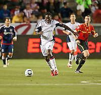 CARSON, CA – APRIL 30, 2011: New England Revolution midfielder Shairie Joseph (21) moves the ball up the field during the match between Chivas USA and New England Revolution at the Home Depot Center, April 30, 2011 in Carson, California. Final score Chivas USA 3, New England Revolution 0.