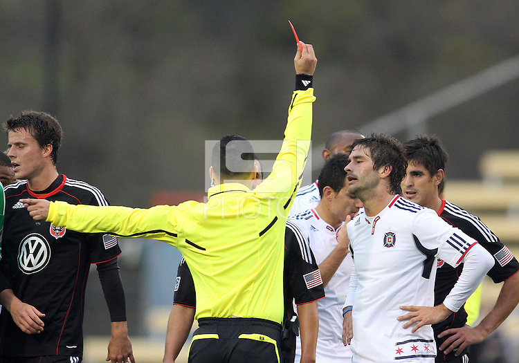 Rodrigo Brasesco#3 of D.C. United watches as Diego Chaves#99 of the Chicago Fire receives a red card during a second round match of the Carolina Challenge on March 9 2011 at Blackbaud Stadium, in Charleston, South Carolina. D.C. United won 1-0.