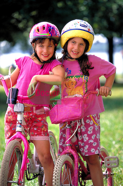 young girls riding bicycles