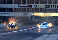 May 15, 2015; Commerce, GA, USA; NHRA funny car driver Jack Beckman (left) explodes an engine on fire alongside John Force during qualifying for the Southern Nationals at Atlanta Dragway. Mandatory Credit: Mark J. Rebilas-USA TODAY Sports