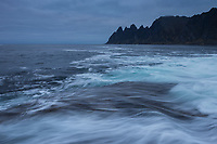 Waves flow over rocks at Tungeneset view point, Senja, Norway