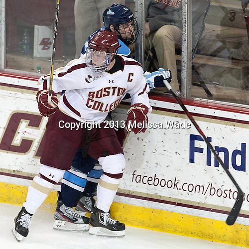 Kyle Williams (Maine - 6), Pat Mullane (BC - 11) - The visiting University of Maine Black Bears defeated the Boston College Eagles 4-1 (EN) on Friday, January 25, 2013, at Kelley Rink in Conte Forum in Chestnut Hill, Massachusetts.