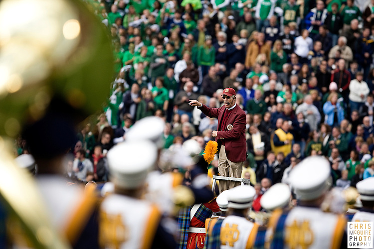 10/17/09 - South Bend, IN:  USC band director Arthur C. Bartner directs the Notre Dame band in the Star Spangled banner prior to their game at Notre Dame Stadium on Saturday.  USC won the game 34-27 to extend its win streak over Notre Dame to 8 games.  Photo by Christopher McGuire.