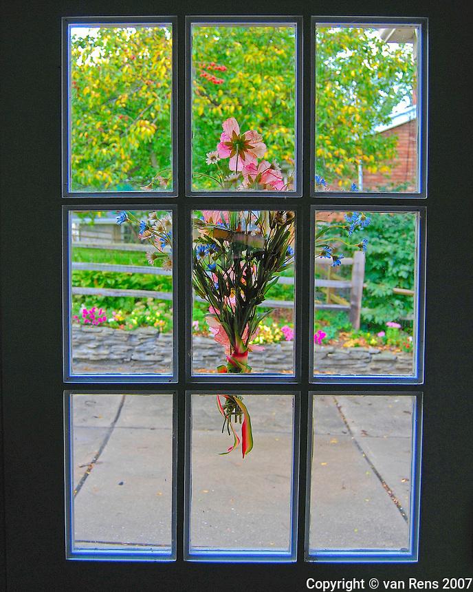Back door flower display welcomes visitors