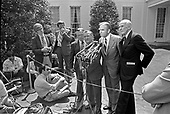 """Members of Congress, from left to right, United States Representative William Broomfield (Republican of Michigan); US Representative Clement Zablocki (Democrat of Wisconsin); US Representative Jim Wright (Democrat of Texas); and US Senator Alan Cranston (Democrat of California) speak to reporters at the White House in Washington, DC after meeting with US President Jimmy Carter on April 24, 1980.<br /> Credit: Benjamin E. """"Gene"""" Forte / CNP"""