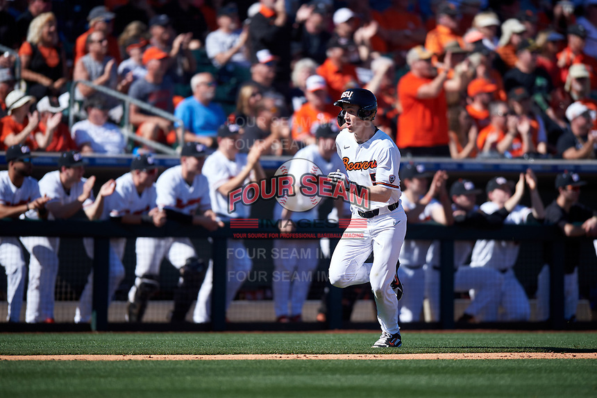 Oregon State Beavers Joe Casey (5) hustles toward home plate during an NCAA game against the New Mexico Lobos at Surprise Stadium on February 14, 2020 in Surprise, Arizona. (Zachary Lucy / Four Seam Images)