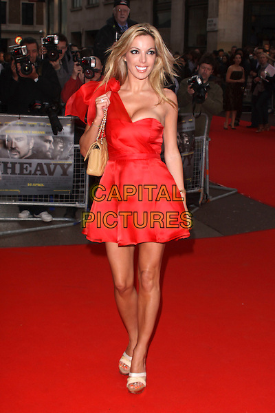 CORALIE ROBINSON.World Premiere of 'The Heavy' at the Odeon West End, Leicester Square, London, England, UK. .April 15th 2010 .full length red one shoulder dress beige Chanel bag cleavage.CAP/AH.©Adam Houghton/Capital Pictures.