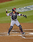 12 October 2012: The St. Louis Cardinals catcher Yadier Molina in action during Postseason Playoff Game 5 of the National League Divisional Series against the Washington Nationals at Nationals Park in Washington, DC. The Cardinals stunned the home team Nats with a four-run rally in the 9th inning to defeat the Nationals 9-7 and win the NLDS, moving on to the NL Championship Series. Mandatory Credit: Ed Wolfstein Photo
