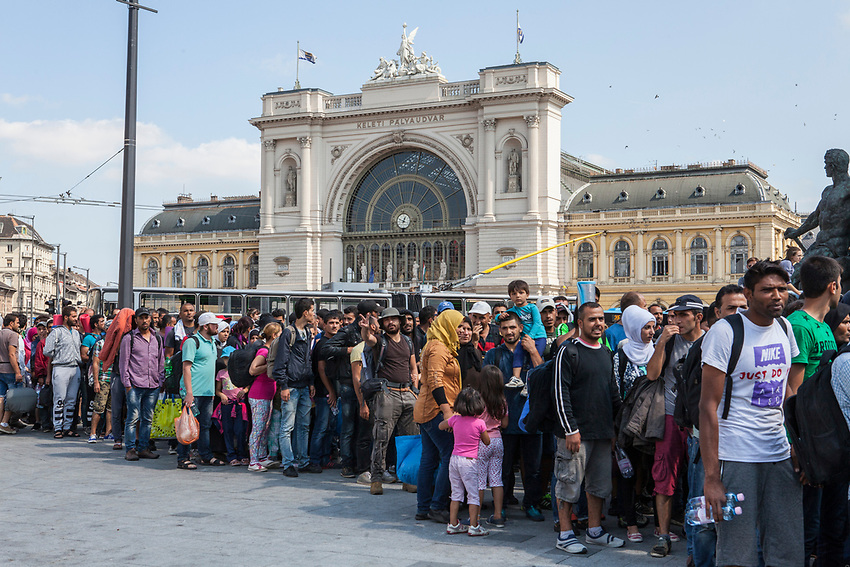Several hundred Refugees left Budapest Railway station after deciding not to wait for trains to Germany. The refugees decided to walk to Austria, first through central Budapest and then crossing the Danube River heading west to Austria.