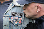 "© Joel Goodman - 07973 332324 . 25/02/2017. Telford, UK. Badge reading "" Speak English or Fuck off "" on the jacket of a man at a Britain First demonstration in Telford , opposed by anti-fascist groups . Britain First say they are highlighting concerns about child sexual exploitation in the town . Photo credit : Joel Goodman"