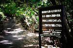 A sign pleads to to those people contemplating suicide to think again and seek advice from friends or family before taking their life at the entrance of Aokigahara Jukai, better known as the Mt. Fuji suicide forest, which is located at the base of Japan's famed mountain west of Tokyo, Japan.