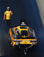 Jun 17, 2016; Bristol, TN, USA; Crew member Matt Bynum with NHRA funny car driver Del Worsham during qualifying for the Thunder Valley Nationals at Bristol Dragway. Mandatory Credit: Mark J. Rebilas-USA TODAY Sports