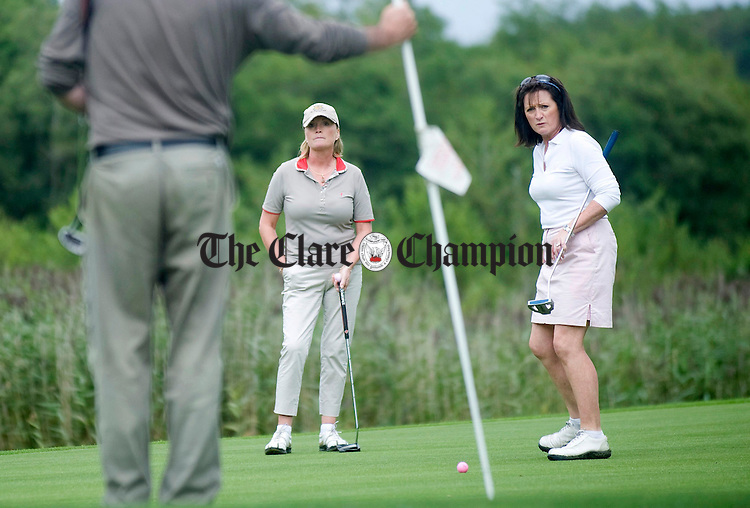 Anne Nix and Julie Fitzgerald on the green during Open Week at Dromoland Golf Club. Photograph by Declan Monaghan