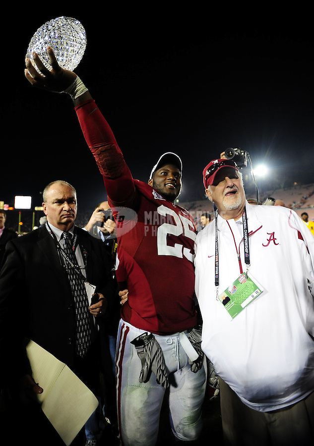 Jan 7, 2010; Pasadena, CA, USA; Alabama Crimson Tide linebacker Rolando McClain (25) holds the Coaches' Trophy after defeating the Texas Longhorns 37-21 in the 2010 BCS national championship game at the Rose Bowl. Mandatory Credit: Mark J. Rebilas-..