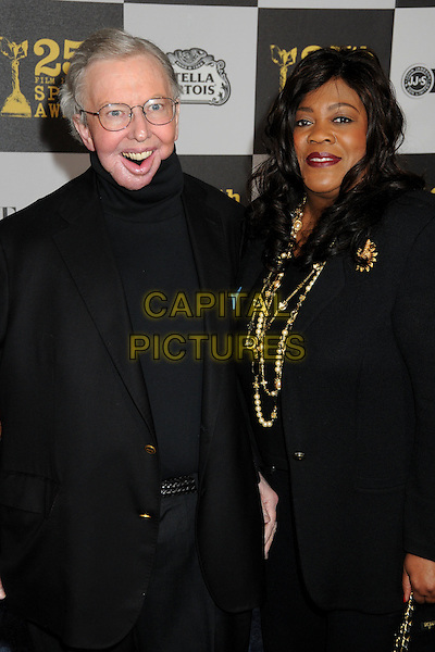 ROGER EBERT & CHAZ HAMMELSMITH EBERT .25th Annual Film Independent Spirit Awards - Arrivals held at the Nokia Event Deck at L.A. Live, Los Angeles, California, USA..March 5th, 2010.half length suit jacket polo neck married husband wife black glasses mouth open plastic surgery.CAP/ADM/BP.©Byron Purvis/AdMedia/Capital Pictures.