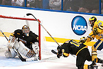 March 26,  2011                      Colorado defenseman Gabe Guentzel (A) (10) falls to the ice as he gets a stick and a push to the back from Michigan forward Derek DeBlois (18) in the third period.  At left is Colorado goalie Joe Howe (31). The University of Michigan defeated Colorado College 2-1 in the championship game of the NCAA Division 1 Men's West Regional Hockey Tournament, on Saturday March 26, 2011 at the Scottrade Center in downtown St. Louis.