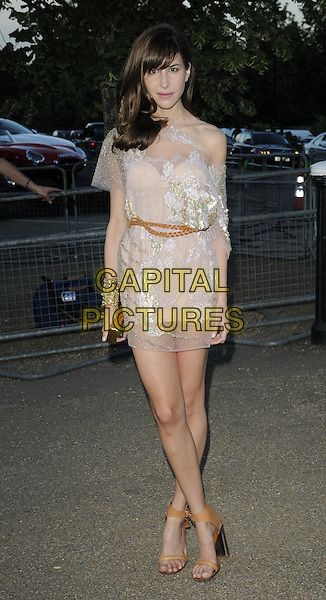CAROLINE SIEBER .At the Serpentine Gallery Summer Party, Serpentine Gallery, Hyde Park, London, England, UK, July 8th 2010..full length nude beige lace sheer see thru through dress gold waist tan brown belt  sandals open toe clutch bag gold cuff bracelet layered ankle strap .CAP/CAN.©Can Nguyen/Capital Pictures.
