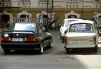 - a BMW car of Federal Republic of Germany (RFT) parked near a Trabant of German Democratic Republic (DDR) ....- automobile BMW della Repubblica Federale Tedesca (RFT ) parcheggiata a fianco di una Trabant  della Repubblica Democratica Tedesca (DDR)..