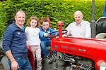 Maurice, Alanah and Evan kelliher Cordal with mike Cahill Brosna at the Paudie Fitzmaurice memorial tractor run in Cordal on Sunday