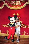 LAKE BUENA VISTA, FL - OCTOBER 01: Young actor / model Jonathan poses with Mickey Mouse while visiting the Cinderella's Castle in the Magic Kingdom during Walt Disney World Resort's 40th Anniversary Celebration at Walt Disney World Resort on October 01, 2011 in Lake Buena Vista, Florida. Walt Disney World opened on October 01, 1971. (Photo by Johnny Louis/jlnphotography.com)