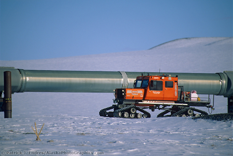 Snow track vehicles travels along the Trans Alaska Oil Pipeline