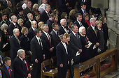Many present and former government officials attended the National Prayer Service at the Washington National Cathedral in Washington, D.C. on Friday, September 14, 2001.  Former United States Presidents Jimmy Carter, Gerald R. Ford, and former Vice President Al Gore sat in the third row behind U.S. President George W. Bush, First Lady Laura Bush, former President George H.W. Bush, Barbara Bush, former U.S. President Bill Clinton, U.S. Senator Hillary Rodham Clinton (Democrat of New York), and Chelsea Clinton.  U.S. Senate Majority Leader Tom Daschle (Democrat of South Dakota) and U.S. House Speaker Dennis Hastert (Republican of Illinois) are in the lower left corner of the photo..Credit: Ron Sachs / CNP