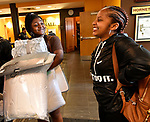 Britney Christian (left) shares a smile with incoming freshman Kai Lloyd of Chicago during freshman move-in day at the Gillespie Residence Hall on the campus of Harris-Stowe State University in St. Louis on Wednesday August 15, 2018.    Photo by Tim Vizer