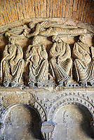 "Early Anglo Saxon sulptures of the Apostles now part of the south porch of Malmesbury Abbey, Wiltshire, England. The apostles, apart from Peter who holds a crude key, have no distinguishing feature to allow identification. Some are holding books, none have halos and some hold their heads at awkward angles. These three styles are typical of Anglo Saxon art. The two panels are 10 ft long and 4ft 6"" high are date from the original Ango Saxon church of 705. They were probablbly built into the proch during the Norman rebuilding. The style of these sculptures is of the Roman Byzantine style and were probably sculpted by masions from Gaul.  Malmesbury Abbey, Wiltshire, England"