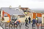 Neighbours of Martin Murphy Castleisland fight to save his house after a section of his roof was blown away in the storm at Laccabawn, castleisland on Wednesday