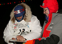 Kim Kittredge signs in with checker Howard Appel at the final check point.