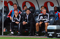 Saturday, 06 October 2012<br /> Pictured: Michael Laudrup manager for Swansea (C) with goalkeeping coach Adrian Tucker (L) and assistant Alan Curtis (R)<br /> Re: Barclays Premier League, Swansea City FC v Reading at the Liberty Stadium, south Wales.
