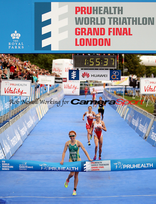 Winner Charlotte Mcshane of Australia crosses the winning line - 2013 ITU World Triathlon Grand Final U23 Women at Hyde Park, London - 12/09/13 - MANDATORY CREDIT: Rob Newell/TGSPHOTO - Self billing applies where appropriate - 0845 094 6026 - contact@tgsphoto.co.uk - NO UNPAID USE