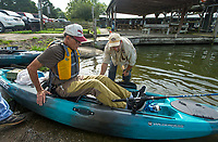 NWA Democrat-Gazette/BEN GOFF @NWABENGOFF<br /> Gary Dieker, a veteran from Siloam Springs, gets in a kayak with help from Jimmy Davis, a veteran from Rogers volunteering to help with the event, Saturday, Aug. 10, 2019, during the Heroes on the Water event at Lake Fayetteville.