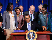 United States President Barack Obama signs the Violence against Women Act on March  7, 2013. From left to right: U.S. Senator Susan Collins (Republican of Maine); Tysheena (Tye) Rhames; U.S. House Democratic Leader Nancy Pelosi (Democrat of California); U.S. Senator Mike Crapo (Republican of Idaho); U.S. Senator Patrick Leahy (Democrat of Vermont); U.S. House Democratic Whip Steny Hoyer (Democrat of Maryland); and U.S. Representative Gwen Moore (Democrat of Wisconsin)..Credit: Dennis Brack / Pool via CNP