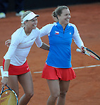 Spain's Silvia Soler Espinosa(L) and Carla Suarez Navarro(R) return a ball to the Czech Republic's pair Andrea Hlavackova and Barbora Barbora Zahalavova Strycova on their women's doubles match of their 2014 International Tennis Federation Fed Cup World Group first-round tie at the Blas Infante tennis centre in Sevilla on February 10, 2014. Czech Republic's pair won doubles 6-7(7),3-6 and the tie 2-3. <br /> PHOTOCALL3000 / GL