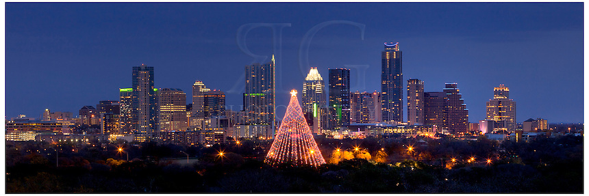 Merry Christmas from Austin, Texas. This Austin skyline is a pano showing the city with the Zilker Tree in the foreground.