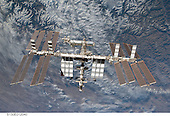 Backdropped by rugged Earth terrain, the International Space Station is featured in this image photographed by an STS-130 crew member on space shuttle Endeavour after the station and shuttle began their post-undocking relative separation. Undocking of the two spacecraft occurred at 7:54 p.m. (EST) on Friday, February 19, 2010..Credit: NASA via CNP