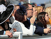 14h April 2018, Aintree Racecourse, Liverpool, England; The 2018 Grand National horse racing festival sponsored by Randox Health, day 3; Racegoers praying for a winning run