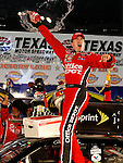 Carl Edwards celebrates after winning the Dickies 500 at TMS on Sunday, November 2, 2008.  (Photo by Khampha Bouaphanh)