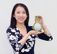 BNPS.co.uk (01202 558833)<br /> Pic: Sworders/BNPS<br /> <br /> Sworders expert Yexue Li.<br /> <br /> A Chinese vase which was bought for £1 in a charity shop could sell for £80,000 because it was made for a 18th century emperor.<br /> <br /> Unaware of its significance, the shopper listed the small yellow florally decorated vase on eBay to see if it was worth anything - only to be inundated with messages and bids.<br /> <br /> Realising the pear-shaped vase, which is designed to be attached to a wall, must be valuable, he removed it from the bidding site and took it to specialists at Sworders Fine Art Auctioneers' in Stansted Mountfitchet, Essex.<br /> <br /> The 8ins Qianlong famille rose vase, found in Hertfordshire, was made around 300 years ago in China and was marked with a symbol that meant it wasn't for export, but for the Emperor's palace.<br /> <br /> It is inscribed with an imperial poem that 'praises incense' and two iron-red seal marks that read 'Qianlong chen han' or 'the Qianlong Emperor's own mark'. It also reads 'Weijing weiyi' - 'be precise, be undivided'.