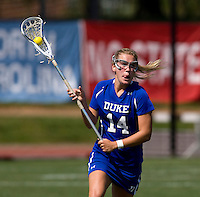 Betsey Sauer (14) of Duke looks for a teammate during the ACC women's lacrosse tournament semifinals in College Park, MD.  North Carolina defeated Duke, 14-4.