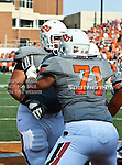 Oklahoma State Cowboys offensive linesman Parker Graham (71) and Oklahoma State Cowboys offensive linesman Lane Taylor (68) in action during the game between the Louisiana-Lafayette Ragin Cajuns and the Oklahoma State Cowboys at the Boone Pickens Stadium in Stillwater, OK. Oklahoma State defeats Louisiana-Lafayette 61 to 34.