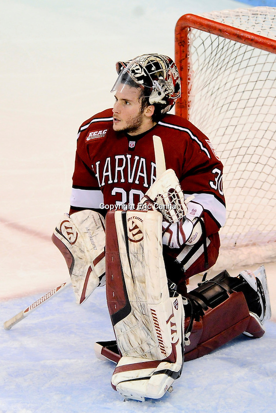Harvard Crimson goalie Raphael Girard (30) during the Harvard University at Boston University NCAA hockey match held at the Agganis Arena in Boston Massachusetts.   Eric Canha/CSM