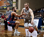 SIOUX FALLS, SD - MARCH 9:  Lucas Huffman #32 from IU East drives past Jake Feickert #12 from Oklahoma Wesleyan in their second round game at the 2018 NAIA DII Men's Basketball Championship at the Sanford Pentagon in Sioux Falls. (Photo by Dave Eggen/Inertia)
