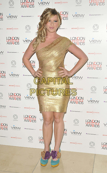 Brooke Kinsella .The London Lifestyle Awards 2011, Park Plaza Riverbank hotel, Albert Embankment, London, England..October 6th, 2011.full length gold one shoulder dress blue purple corsage shoes hands on hips.CAP/CAN.©Can Nguyen/Capital Pictures.